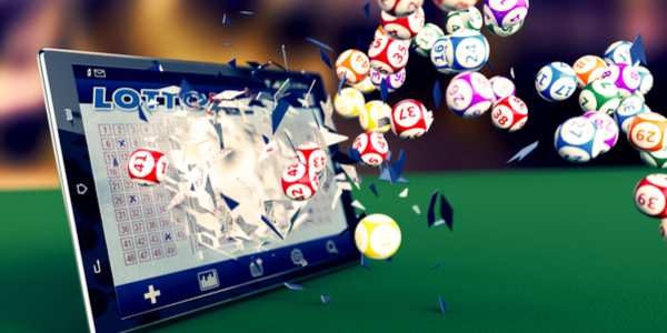 Tablet pc with a lottery app and lottery balls coming out by breaking the glass